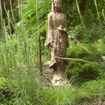 Statue of Buddhist goddess, Guanyin in front of Kentucky Coffeetree