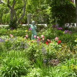 Grecian Statue in Spring Garden with Alliums and Tulips