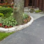 Fond Du Lac Wall Stone Retaining Wall Adds Curb Appeal. Plantings make for a cheery arrival.