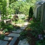 Re-used Stone and Recycled Concrete make pleasant path near the stump garden