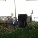 Before. Pretty ugly air conditioner and gas meter and pipes