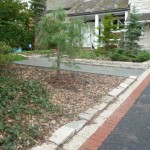 Clay brick  and Unilock pavers combine to enhance an asphalt driveway