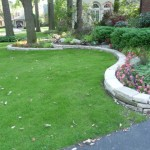 Fond du Lac Wall Stone Expertly Laid Make Beautiful Curved Beds in Front of Home
